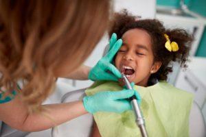 Little girl visiting her Nashua pediatric dentist