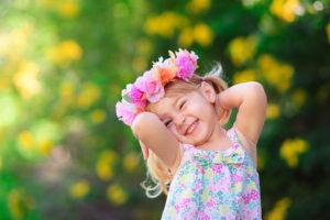 Smiling girl with flower crown enjoying Spring Break
